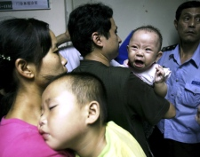 Children and parents wait to see doctors at a hospital where there have been several cases of children developing kidney stones after consuming tainted milk formula in Wuhan, central China's Hubei province Wednesday Sept. 17, 2008. (AP)