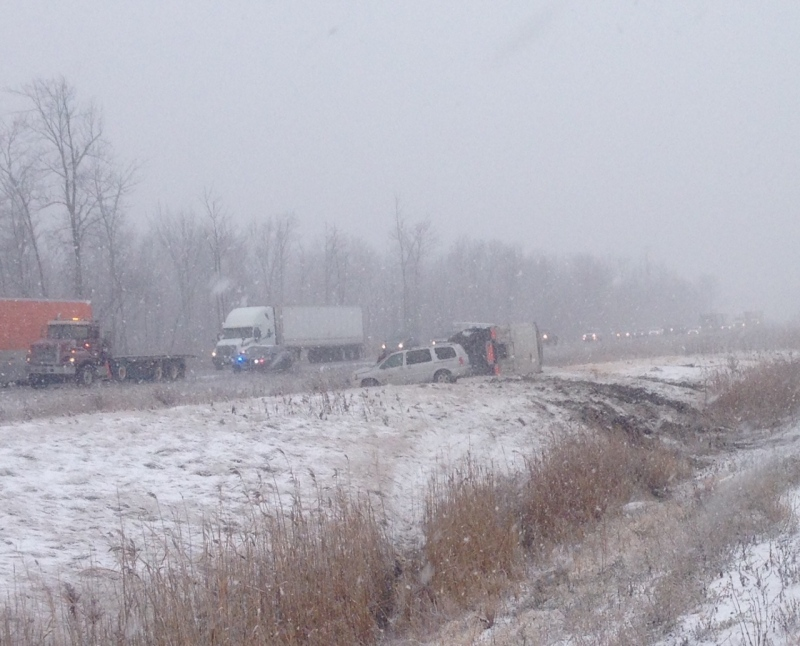 Near white-out conditions and vehicles in the ditch on Highway 402 west of Strathroy on Nov. 7, 2014. (Gerry Dewan / CTV London)