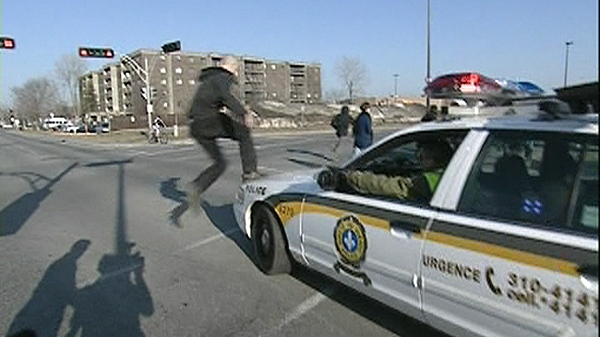 A protester that was blocking the Champlain Bridge tries to run away from police officers (March 20, 2012)