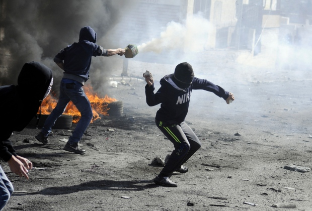 Tensions have been rising in recent weeks over the Jerusalem shrine, known to Muslims as Haram al-Sharif, or Noble Sanctuary, and to Jews as the Temple Mount.<br><br>Palestinians throw rocks and shoot fireworks during clashes with Israeli border police, as Israeli police limited the access to Al-Aqsa Mosque in Jerusalem on Friday, Nov. 7, 2014. (AP / Mahmoud Illean)