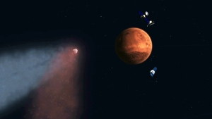This handout artist's concept provided by NASA/JPL shows the Comet Siding Spring approaching Mars, shown with NASA's orbiters preparing to make science observations of this unique encounter. (AP Photo/NASA/JPL)