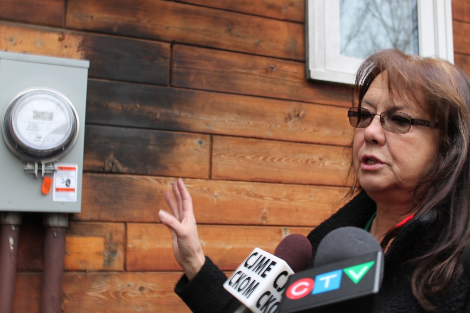 Joan Riemer speaks to reporters about a smart meter fire that happened at her home in east Regina early Friday.