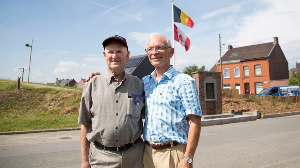 George Barkhouse from Nova Scotia and the mayor of the village of Le Roeulx, Albert Tesain, pose in front of the George Price Memorial in Ville-sur-Haine, Belgium on Sunday, Aug. 3, 2014. Barkhouse's uncle, Pvt. George Lawrence Price was killed in action just two minutes before the Armistice. (AP / Virginia Mayo)
