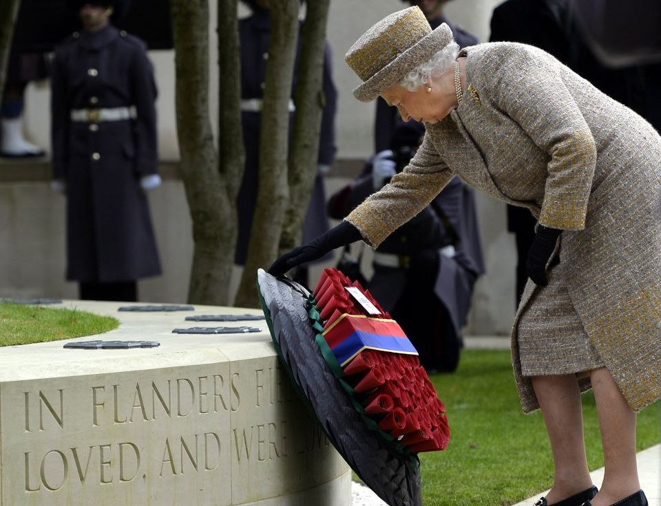 Britain's Queen Elizabeth places a wreath during the inauguration of the Flanders' Fields Memorial Garden at Wellington Barracks in London, on Thursday, Nov. 6, 2014. (AP Photo/Eric Lalmand)