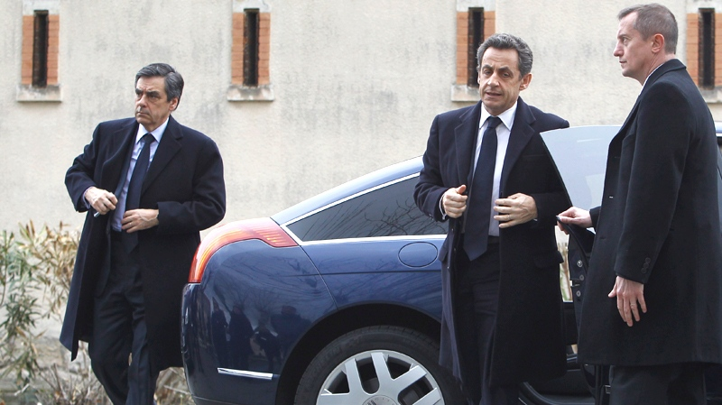 French President Nicolas Sarkozy, second right, and Prime Minister Francois Fillon, left, arrive to meet police officers close to the apartment building where a suspect in the shooting at the Ozar Hatorah Jewish school is barricaded in Toulouse, southern France, Wednesday, March 21, 2012. (AP / Christophe Ena)