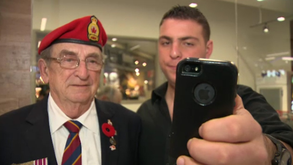 War veteran Les Newman poses for a #PoppyProud selfie with college student Adam Luxenberg on Saturday, Nov. 8, 2014.