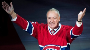 Former Montreal Canadien Guy Lapointe salutes the crowd as his number is raised during a retirement ceremony prior to an NHL hockey game between the Canadiens and the Minnesota Wild in Montreal, Saturday, November 8, 2014. THE CANADIAN PRESS/Graham Hughes