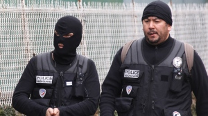 In this file photo, police officers stand near a building in Toulouse, France, Wednesday, March 21, 2012. (AP / Bob Edme)