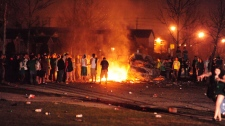 A vehicle burns during a riot on London, Ont., in the early hours of Sunday, March 18, 2012. (THE CANADIAN PRESS/London Community News-Mike Maloney)