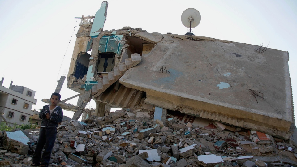 A boy stands on debris of a building destroyed by the Egyptian army on the Egyptian side of border town of Rafah, northeast of Cairo, Egypt, Thursday, Nov. 6, 2014. (AP / El Shorouk newspaper, Ahmed Abd El-Latif)