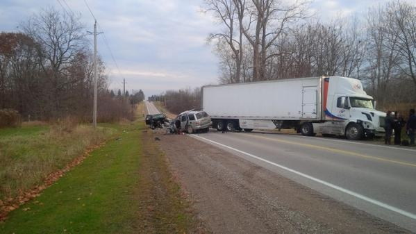 Two vehicles and a transport are seen following a fatal crash near Glencoe, Ont. on Monday, Nov. 10, 2014. (Bryan Bicknell / CTV London)