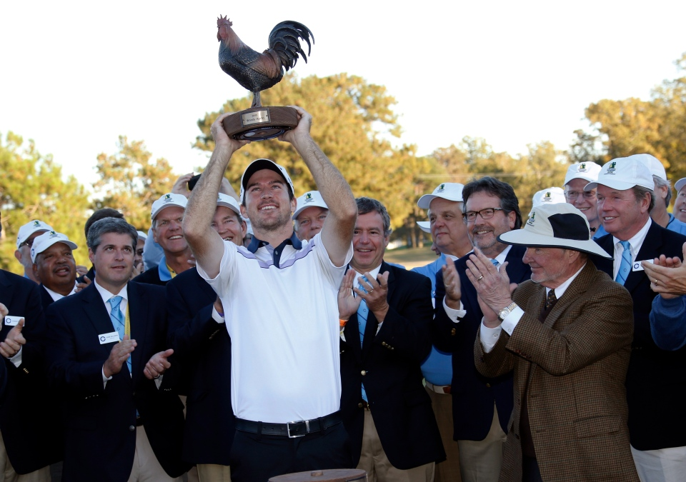 Nick Taylor hoists the trophy after winning the Sanderson Farms Championship trophy in Jackson, Miss., Sunday, Nov. 9, 2014. (AP / Rogelio V. Solis)