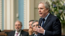 Quebec Premier Jean Charest responds to Opposition questions over laid-off workers from the Aveos plant at the legislature in Quebec City on Wednesday, March 21, 2012. (Jacques Boissinot / THE CANADIAN PRESS)
