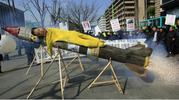 An effigy of North Korean leader Kim Jong Un is put on a mock North Korean missile during an anti-North Korea rally denouncing North's plan to launch a long-range rocket in Seoul, Tuesday, March 20, 2012. (AP Photo/Lee Jin-man)