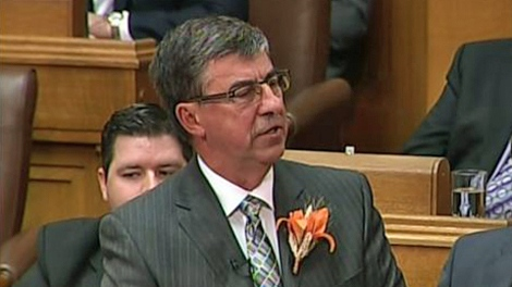 Finance Minister Ken Krawetz delivers the provincial budget at the Saskatchewan legislature in Regina on Wednesday.