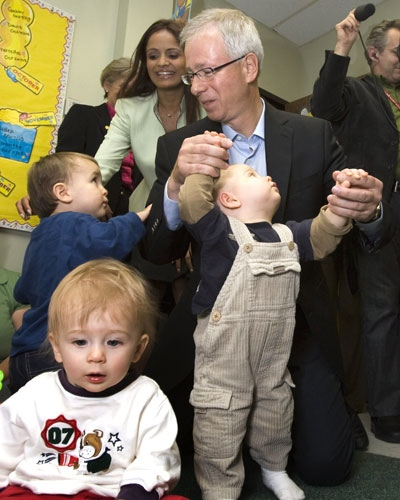 Liberal leader Stephane Dion has his hands full as he plays with children at Conestoga College in Kitchener, Ont., on Wednesday, Sept. 17, 2008. (Frank Gunn / THE CANADIAN PRESS)
