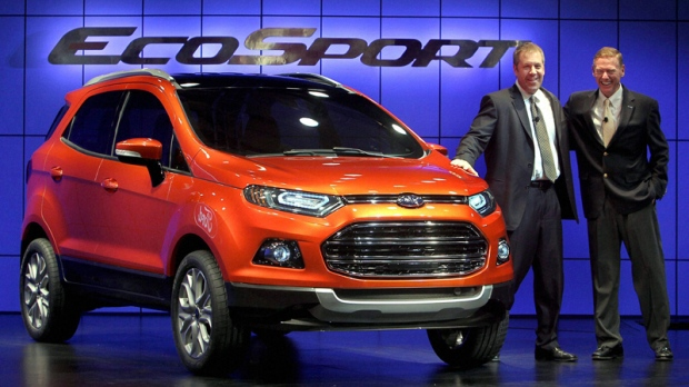 President and Chief Executive Officer of Ford Motor Company Alan Mulally, right, and Group Vice President and President of Asia Pacific & Africa Joe Hinrichs pose with the newly launched Ford Ecosport in New Delhi, India, Wednesday, Jan. 4, 2012. EcoSport is the first Ford global model designed and developed entirely by its South American team. (AP Photo)