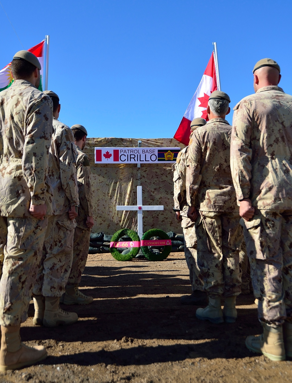Members of the Canadian Special Operations Force Command stand at attention at the naming ceremony for the new Canadian Special Operations Force Command Patrol Base Cirillo during Operation IMPACT in Iraq on November 6, 2014. (Canadian Forces Combat Camera / DND)