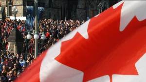 Thousands gather at the National War Memorial in Ottawa to pay tribute to Canada's fallen soldiers, Tuesday, Nov. 11, 2014.