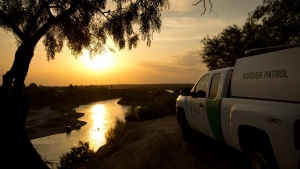 A U.S. Border Patrol agent keeps watch in Roma, Texas, across the Rio Grande River from Tamaulipas, Mexico on July 23, 2014. (Austin American-Statesman / Jay Janner)