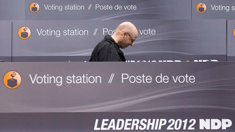 A worker walks through the voting stations as the NDP get ready for the party leadership convention in Toronto. (Nathan Denette / THE CANADIAN PRESS)