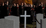 Members of the Honour Guard pause for a moment of silence during the Remembrance Day ceremony at the National Military Cemetery in Ottawa, Tuesday, Nov. 11, 2014 . (Fred Chartrand / THE CANADIAN PRESS)