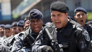Police shout as they prepare to patrol different slums known as favelas in Rio de Janeiro, Brazil on Oct. 24, 2014. (AP / Silvia Izquierdo)