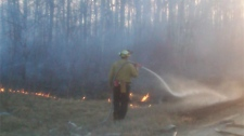 Crews battle a wildfire in the RM of Stuartburn in Manitoba on March 22, 2012.