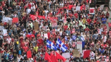 Thousands of students march during a demonstration against tuition hikes Thursday, March 22, 2012 in Montreal.(Paul Chiasson /  THE CANADIAN PRESS)