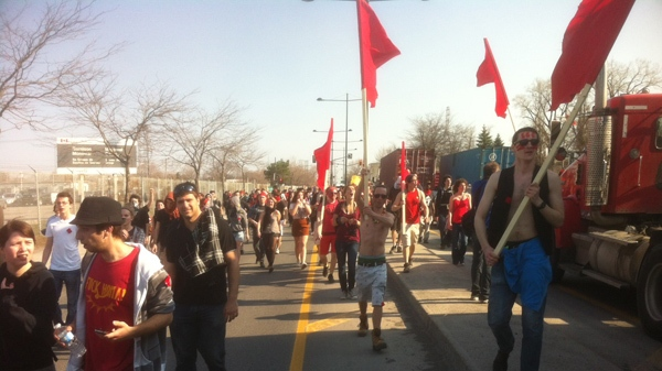 Protesters opposed to tuition hikes march along Notre Dame St. in Montreal (March 22, 2012, CTV Montreal/Marc Latendresse)