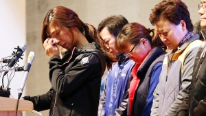 Relatives of the nine missing passengers of the sunken ferry Sewol cry during a news conference at a gym on South Korea's southwestern island of Jindo, where they have been staying at since the April 16 sinking of ferry Sewol, in Jindo, South Korea, Tuesday, Nov. 11, 2014. (AP / Yonhap / Park Chul-hong)