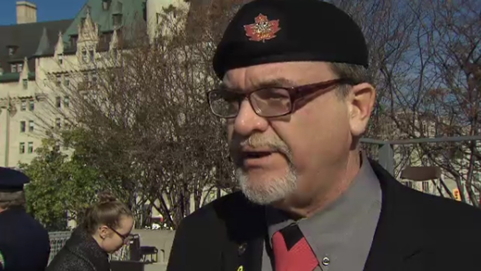 Canadian Veterans Advocacy president and founder Michael Blais speaks near the National War Memorial in Ottawa on Remembrance Day, Tuesday, Nov. 11, 2014.