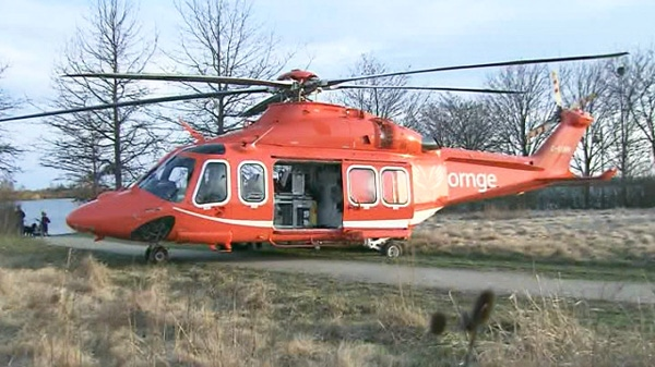 An Ornge air ambulance helicopter is shown after making an emergency landing in Colonel Samuel Smith Park near Humber College, Friday, March 23, 2012.
