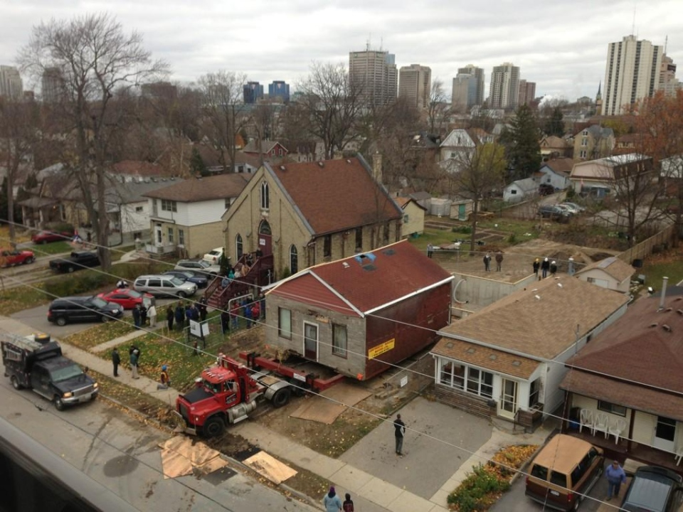 The Fugitive Slave Chapel is being moved into place at 432 Grey Street in London, Ont., on Nov.12, 2014. (Bryan Bicknell / CTV London)