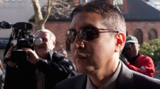 """RCMP officer Cpl. Benjamin """"Monty"""" Robinson arrives at court in New Westminister, B.C. Friday, March, 23, 2012. Robinson was found guilty of trying to avoid impaired driving charges by using police training after he was involved in a fatal crash in 2008. (THE CANADIAN PRESS/Jonathan Hayward)"""