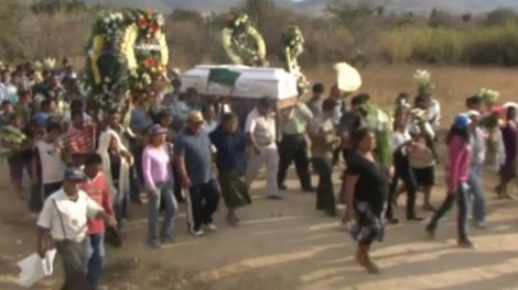 Mourners in Oaxaca, Mexico carry the casket for Bernardo Vasquez, an anti-mining activist shot dead in his car.