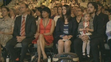 Olivia Chow sits next to Michael Layton (left), Sara Campbell (second from right), and Hugh Campbell (far right) during a tribute for NDP leader Jack Layton during the NDP leadership convention in Toronto on Friday, March 23, 2012.
