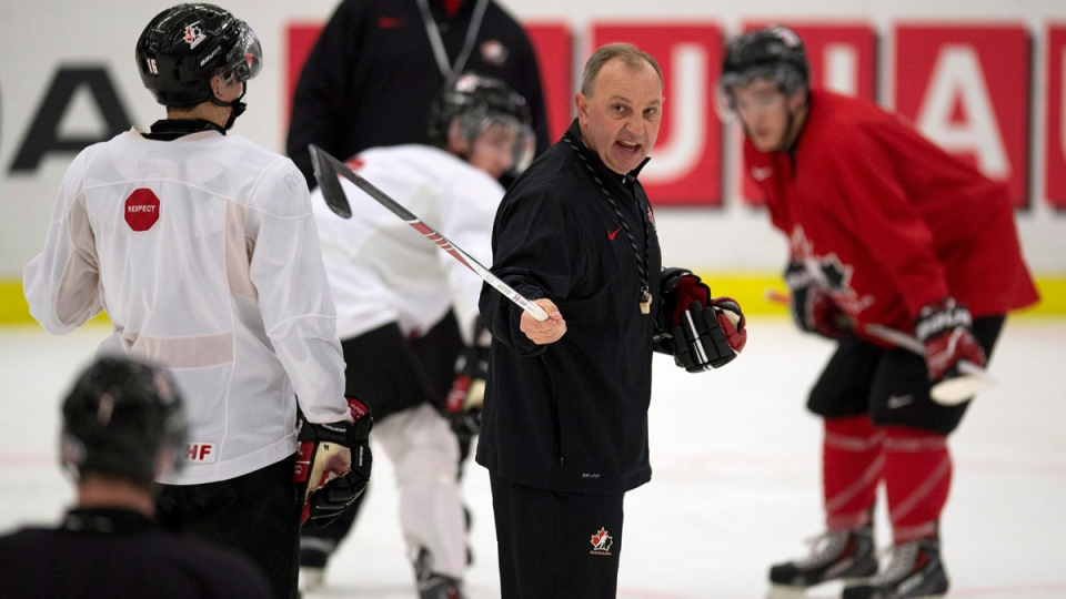 Canada head coach Brent Sutter calls plays during team practice at the IIHF World Junior Hockey Championships in Malmo, Sweden on Sunday, Dec. 29, 2013. (Frank Gunn / THE CANADIAN PRESS)