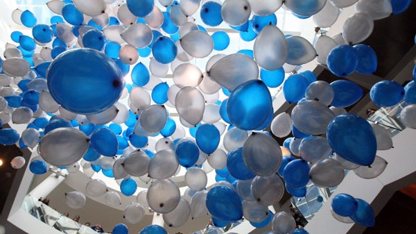 Hundreds of balloons are released at the University of Memphis on Wednesday, Jan. 18, 2012 in Memphis, Tenn. (AP Photo, The Commercial Appeal, Mike Maplel)