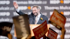 NDP leadership candidate Thomas Mulcair waves after speaking during the NDP leadership convention in Toronto on Friday, March 23, 2012. (Pawel Dwulit / THE CANADIAN PRESS)
