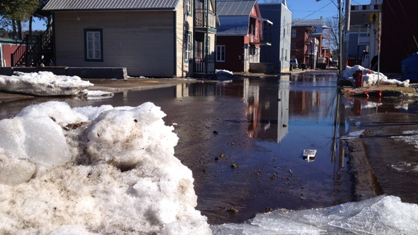 St. Ignace St., near the Sainte Anne river in Saint Raymond, shows signs of spring flooding (March 23, 2012, CTV Montreal, Frederic Bissonnette)