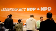 Delegates register at the start of the NDP leadership convention in Toronto on Friday, March 23, 2012. (Pawel Dwulit / THE CANADIAN PRESS)