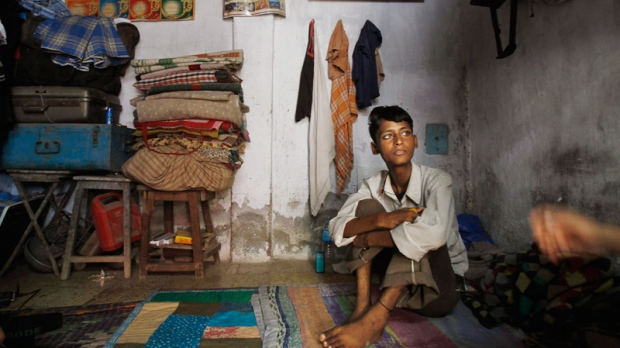Mohammed Shamim Sheikh, who suffers from multi-drug-resistant tuberculosis, listens to a social worker at his home in a slum on the outskirts of Mumbai, India, Monday, Jan. 16, 2012. (AP / Rafiq Maqbool)