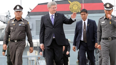 Prime Minister Stephen Harper is given a tour by the Royal Thai Police marine division in Bangkok, Thailand on Saturday, March 24, 2012. (Sean Kilpatrick / THE CANADIAN PRESS)