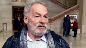 Ivan Henry speaks in the foyer of the Supreme Court of Canada on Thursday, Nov. 13, 2014.
