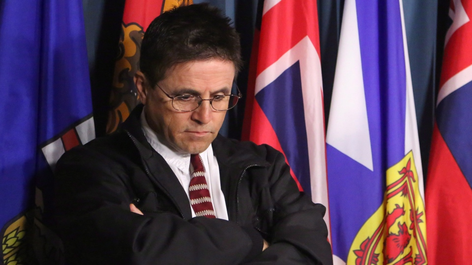 Hassan Diab, the Ottawa professor who has been ordered extradited to France by the Canadian government, listens to his lawyer speak at a press conference on Parliament Hill in Ottawa on Friday, April 13, 2012. ( Patrick Doyle / THE CANADIAN PRESS)