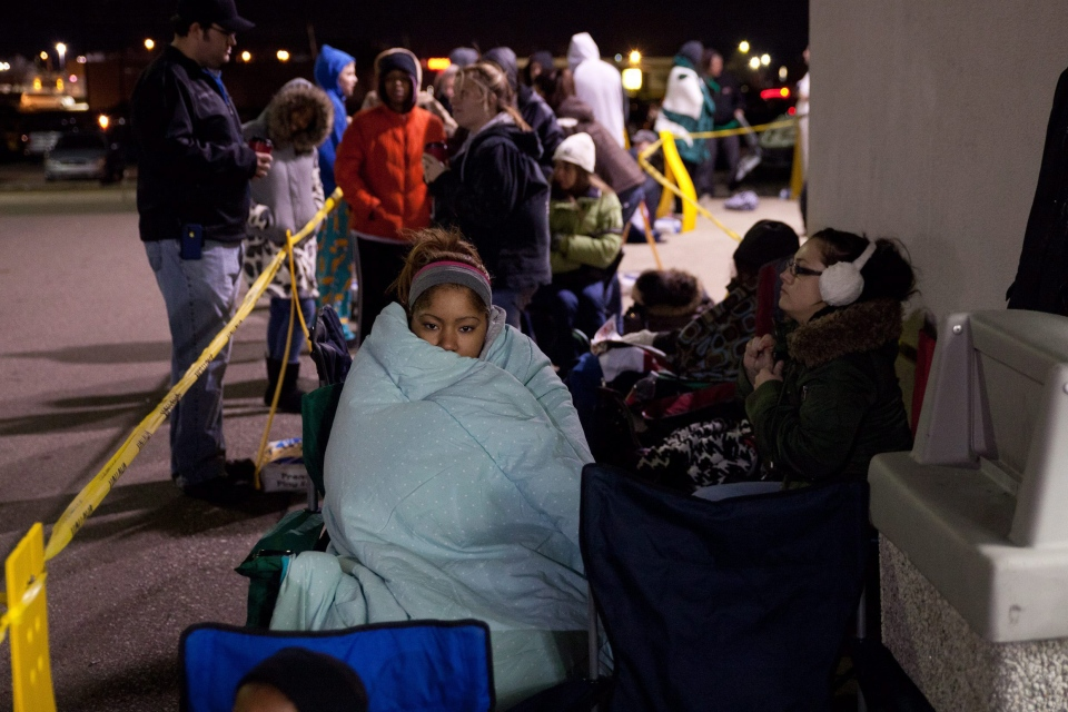"Suffering for a sale? Black Friday shoppers wait in line for Toys ""R"" Us to open on Nov. 22, 2012, in Flint, Mich. (AP / Griffin Moores)"