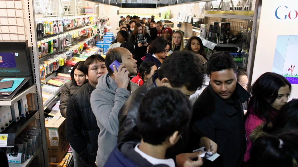 Sales stampede. Black Friday customers at a Best Buy store on Nov. 23, 2012, in Philadelphia. (AP / Joseph Kaczmarek)