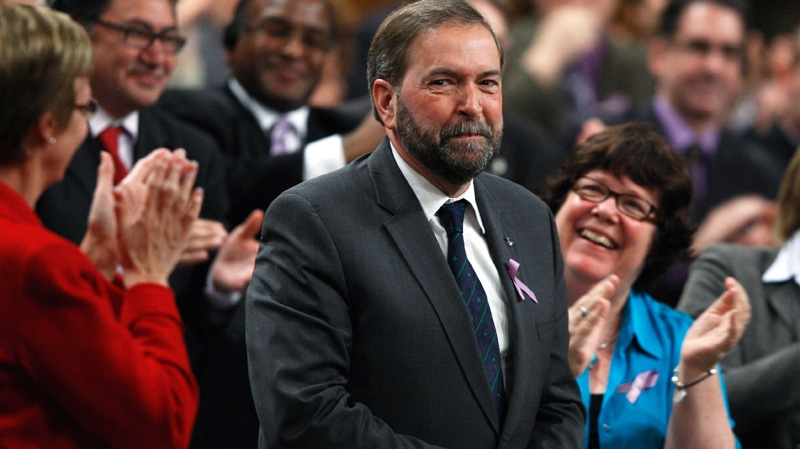 Newly-elected NDP Leader Thomas Mulcair receives applause during question period in the House of Commons in Ottawa, Monday, March 26, 2012. (Adrian Wyld / THE CANADIAN PRESS)