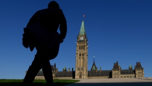 A man walks on Parliament Hill on September 15, 2014.  (Sean Kilpatrick/THE CANADIAN PRESS)
